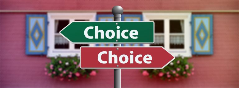 Two choice signs pointing opposite directions.