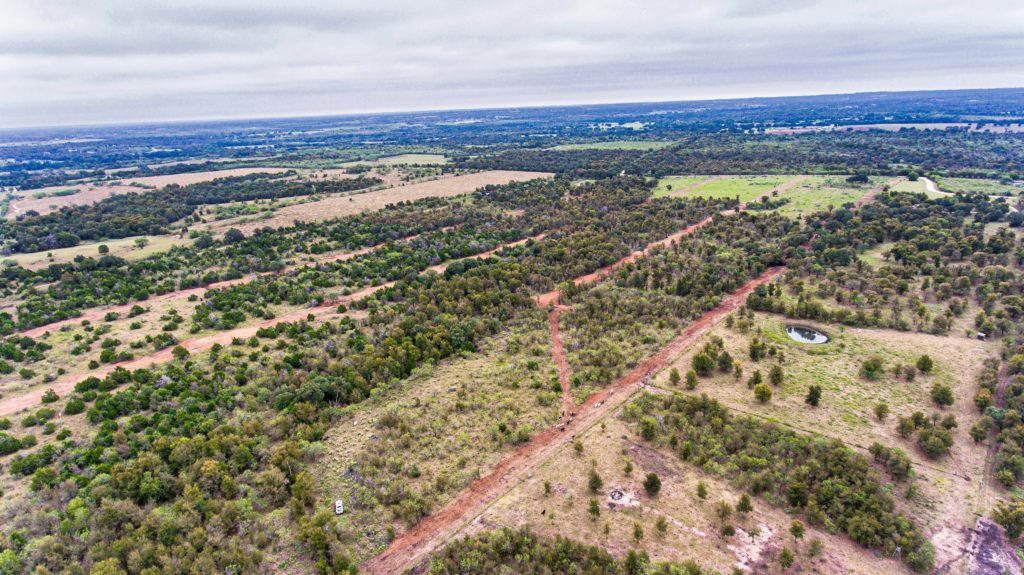 sky view of land for sale with many trees and beautiful views
